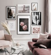 Elegant gallery wall with feminine motifs and an inspirational quote